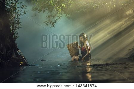 Asian sexy woman bathing in cascade Thailand