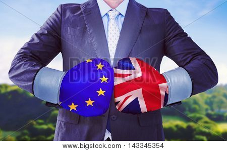 Businessman with boxing gloves against digitally generated great britain national flag