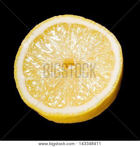 Close Up Of A Sliced Lemon Over Black