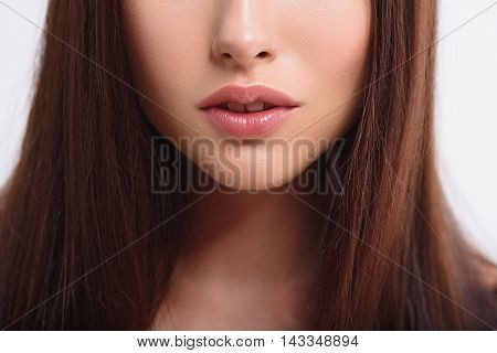 Close up of female face with voluptuous lips. Woman is standing and expressing passion