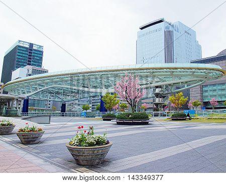Nagoya Japan - April 15 2010: Colorful flowers in front of Oasis 21 a modern complex in Nagoya