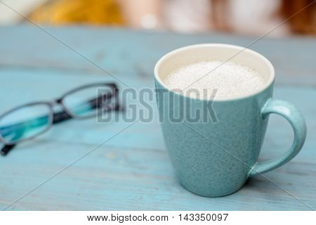 good morning Coffee cup on blue rustic background