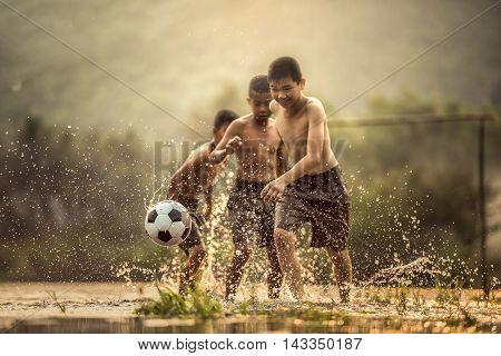 Boy kicking a soccer ball (Focus on soccer ball)