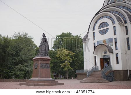 Rostov-on-Don Russia -August 142016: Monument to Empress Elizabeth. Sculptors: S.Oleshnya A.Dementev. In the background the parishioners of the church