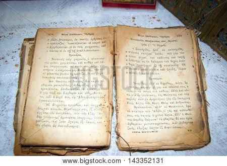Opened old book in Latin with yellowed pages on the table