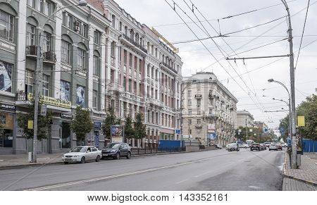 Rostov-on-Don Russia -August 14 2016: The building of the Rostov State University of Economics (RINH). Nearby pedestrians and moving vehicles