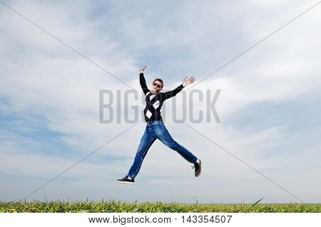 Young Man Jumping On Sky Background