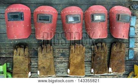 Welding safety mask and glove in workshop factory
