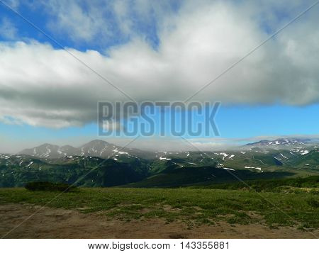 White clouds over the mountains of Kamchatka