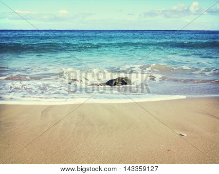 beach scene with rocks in the water and turquoise sea. Copy space.