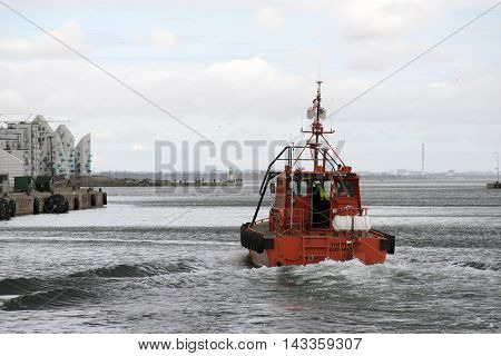AARHUS DENMARK - AUGUST 14 2016: Pilot Boat Thrym in action. Aarhus Port is the largest container port in Denmark August 14 2016