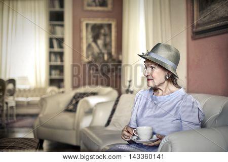Classy lady drinking tea