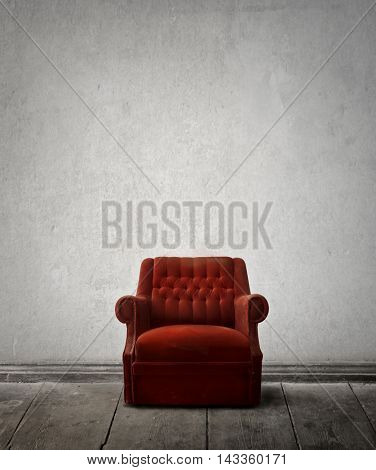 Red armchair inside an empty room