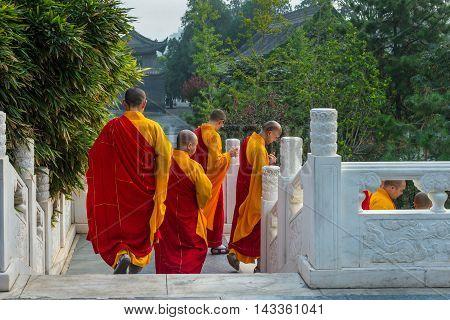 Xian China - October 17 2013: Monks at Giant Wild Goose Pagoda Xi'an Shaanxi Province China.