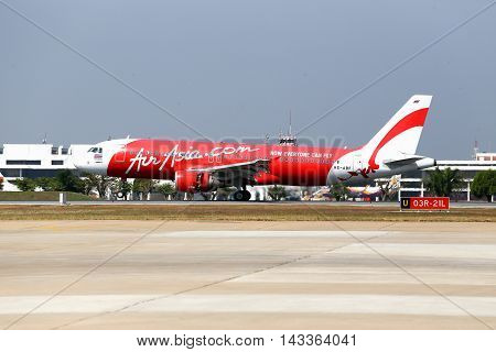 BangkokThailand-January 112014: HS-ABF Thai Air asia Airbus a320-216 touching down and use trust reverser on runway at Don Mueang International Airport.Thai Air Asia company is one of low cost airlines in Asia