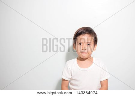3 years old cute and healthy Asian boy with white t shirt smile isolated on white background