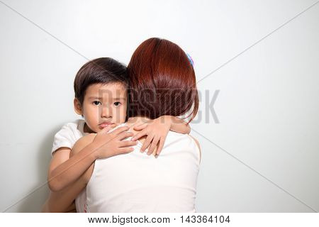 3 years old cute Asian kid hug his mother on white background