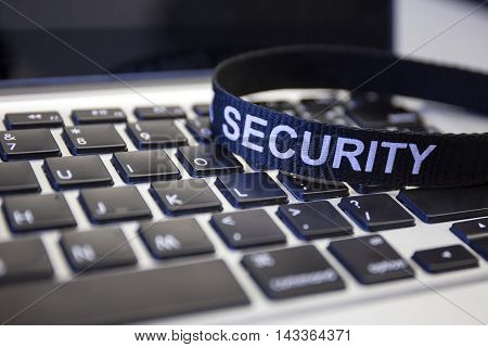 word security on labtop keyboard symbolized computer crime protection