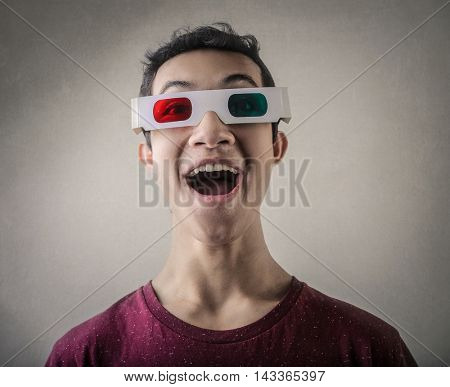 Amazed man wearing 3D glasses