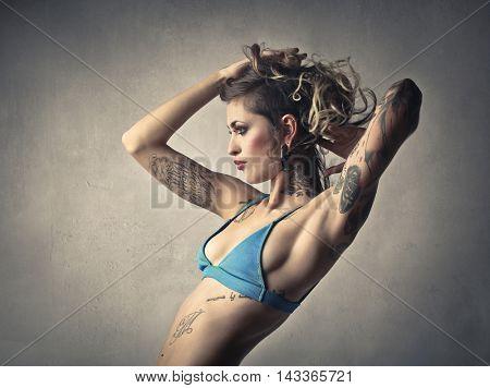 Fashionable woman wearing a blue bikini
