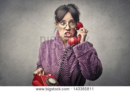 Worried woman in bathrobe doing a phone call