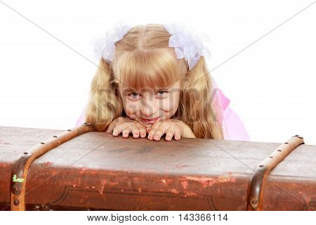Beautiful little girl hid behind an old suitcase-Isolated on white background
