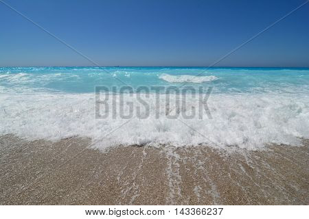 game of turquoise waves in a windy day on Lefkada island Kathisma beach Greece