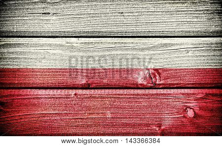 flag of Poland painted on old grungy wooden background: 3d illustration