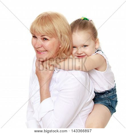 Happy little girl riding on the back of his grandmother - Isolated on white background