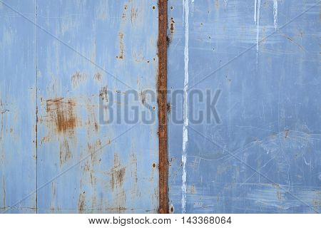 Rusty scratched grunge metal wall detailed texture background