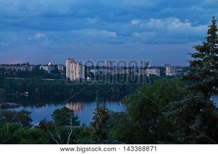 Evening cityscape of Zaporozhye on the banks of the Dnieper River Ukraine