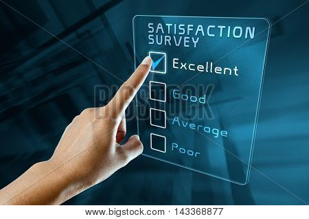 hand clicking online customer satisfaction survey on virtual screen interface