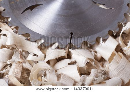 Construction tools on wooden table with sawdust. Joiner carpenter workplace top view