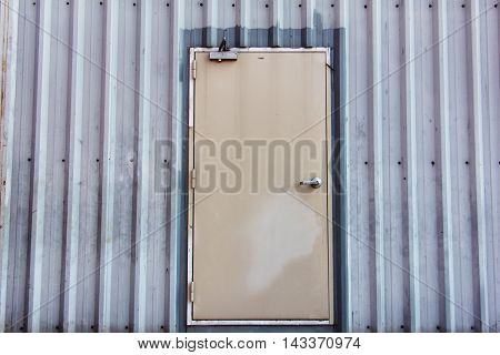 iron door on corrugated metal sheet, industrial concept
