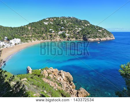 Beach of Cala San Vicent on Ibiza Island, turquoise sea and empty beach.