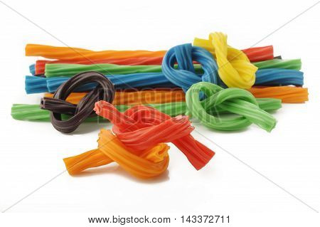 colorful licorice candy shaped like a twisted rope on white background