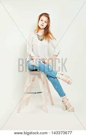 Young Fashion Model. Studio Fashion Photo on white