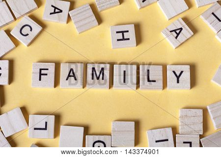 family word on a wooden blocks. Wood abc.