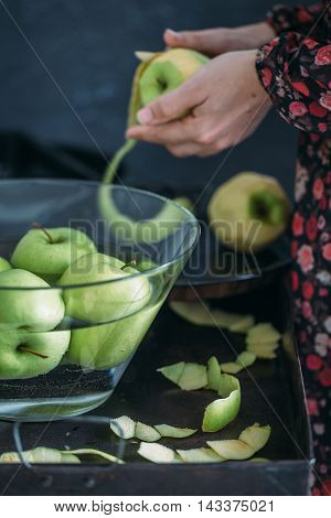 woman peeled green apple. food style concept