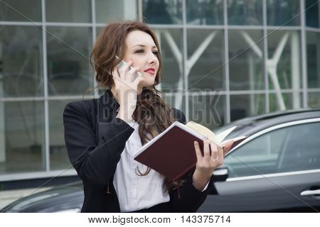 Business Woman On Phone Standing In The Street Background Car