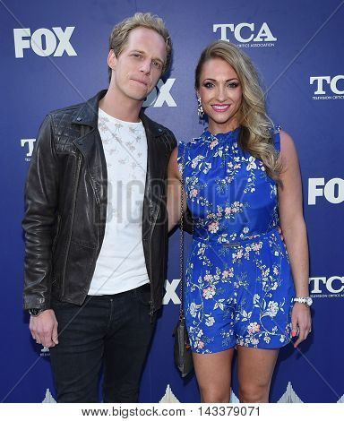 LOS ANGELES - AUG 08:  Chris Geere & Jennifer Sawdon  arrives to the FOX Summer TCA Party 2016 on August 08, 2016 in West Hollywood, CA