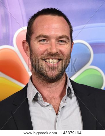LOS ANGELES - AUG 02:  Sullivan Stapleton arrives to the NBC Universal TCA Summer Press Tour 2016 on August 02, 2016 in Beverly Hills, CA