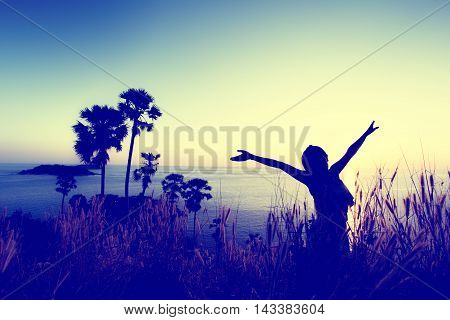 Woman pulls hands to the sky. Freedom - conceptual photography (Vintage color)