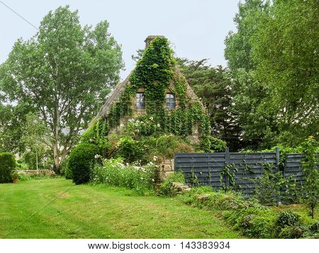 overgrown house in Plouharnel a commune in the Morbihane department of Brittany in France