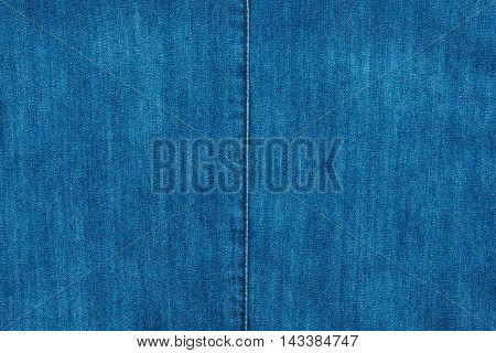 Blue seam on blue denim fashion background texture