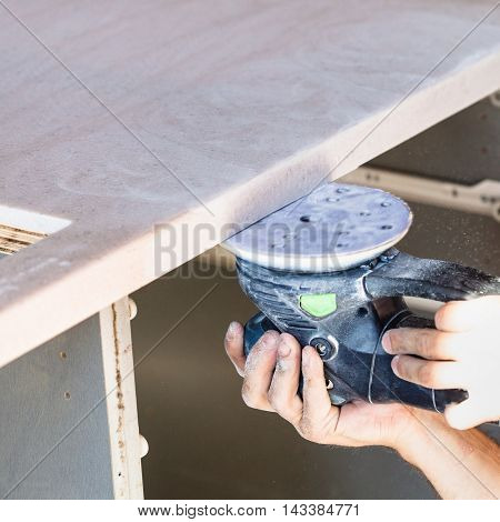 Worker Polishing Worktop From Artificial Stone