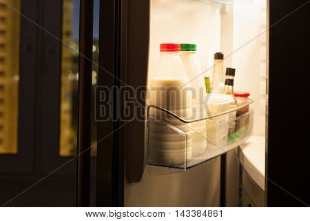 Home Fridge With Dairy Products In Night