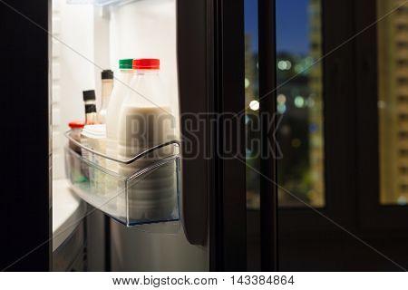 Home Fridge With Milk Bottles In Night