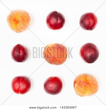 Several Nectarines And Peaches Arranged In Square