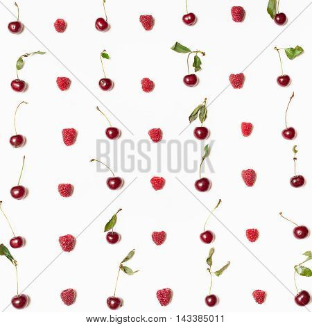 Many Raspberries And Cherries Arranged On Square